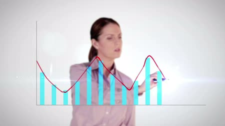 analiza : Digitally generated of happy businesswoman drawing hologram graph on white background Wideo