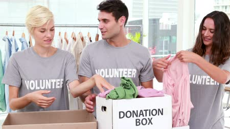 пожертвование : HD video of volunteers friends holding donation boxes