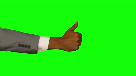 tenso : Close up of hand gesturing thumbs up on green screen background Vídeos