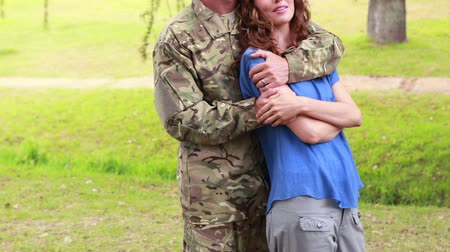 asker : Happy soldier hugging his wife in park