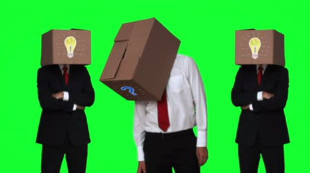 noktalama : Team of businessman hiding head with box on green screen background