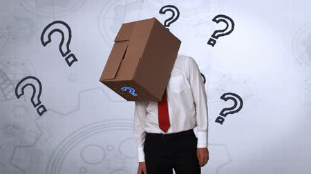 kutu : Businessman looking down with box on head on grey background