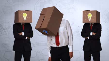 noktalama : Team of businessman hiding head with box on abstract background