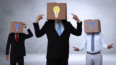 sorular : Team of businessman hiding head with box and gesturing on grey background Stok Video