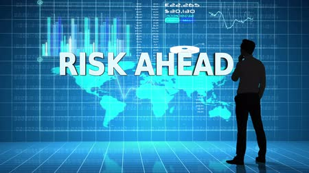 lucros : Digital animation of Businessman in front of global business interface with the word Risk Ahead