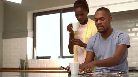 hot news : Happy couple having coffee together in the morning in slow motion