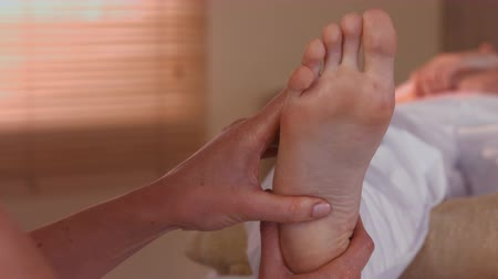 akupresura : Woman enjoying a foot massage in high quality 4k format