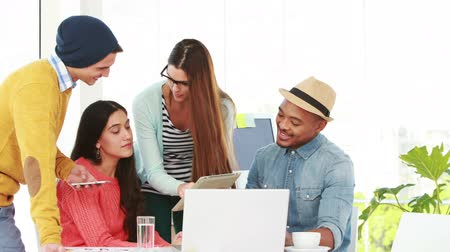 hipster : Creative hipster team working together in an office with a laptop ad tablet Stock Footage