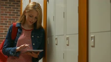 прихожая : Student looking through her tablet  in the university college
