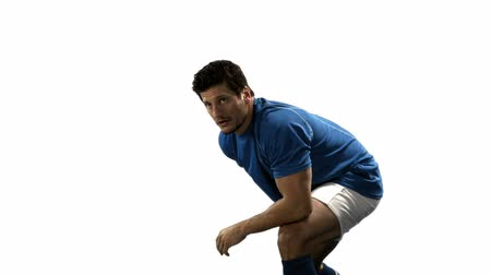 ciddi : Serious rugby player playing in slow motion on white background