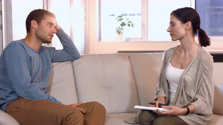 counselling : Casual businessman speaking with psychologist in office Stock Footage