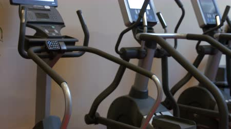 elliptical : Exercise equipment in the studio in ultra 4k format Stock Footage