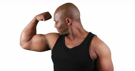 bicep : Smiling muscular man with meat flexing muscles on white background