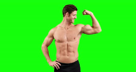 bicep : Muscular man flexing his muscles on green background