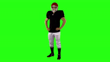 equipamentos esportivos : American football player with hands on hips on green background Vídeos