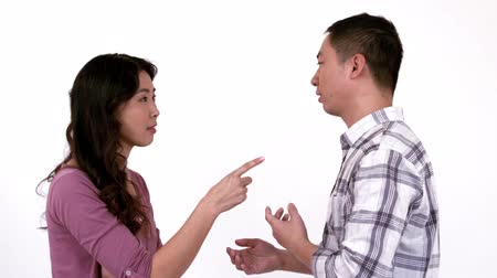 harc : Angry young couple having a dispute against white background