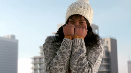 cold : Woman shivering on a winters day in slow motion