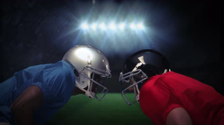 helmets : Serious american football player looking at each other in stadium Stock Footage