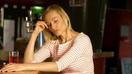 apprehensive : Stressed woman sitting at bar in high quality