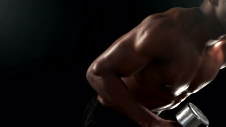 highspeed : Fit man lifting heavy black dumbbell in slow motion