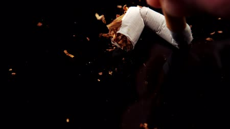 carcinogenic : Hand squashing a cigarette in slow motion Stock Footage