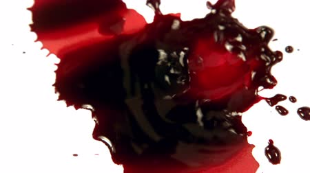 blood sample : Blood dropping on white surface in slow motion