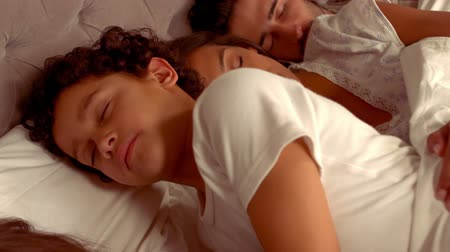 family life : Hispanic family sleep in the bed at home