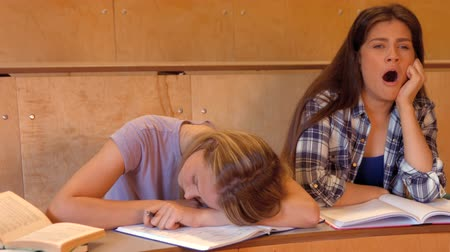 unott : Student asleep with partner on the verge of falling asleep