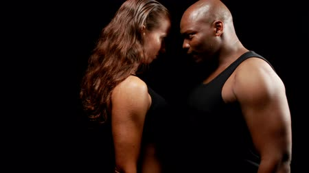 yarışma : Male and female boxer looking at each other on black background Stok Video