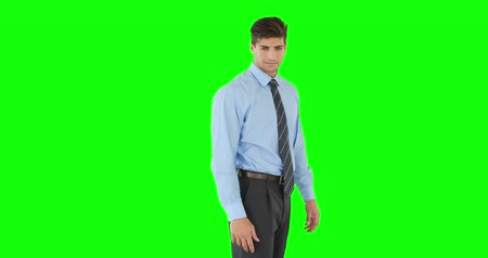 krawat : Businessman scrolling on invisible screen on green background
