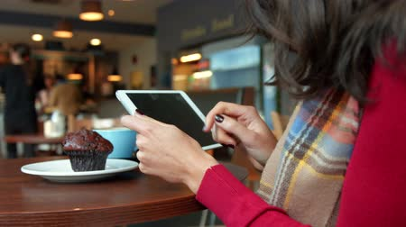 coffee time : Pretty brunette having a coffee in cafe using tablet in high quality format Stock Footage