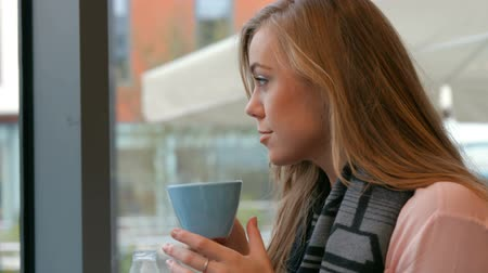 coffee time : Pretty blonde enjoying coffee in cafe in high quality format