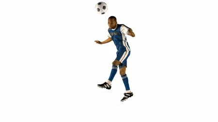 piłka nożna : Football player heading the ball on white background
