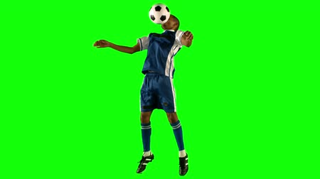 jogadores : Football player chesting the ball on green baackground