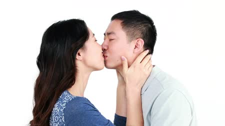 krk : Happy Asian couple kissing and smiling on white screen