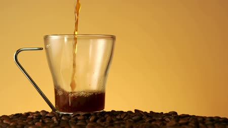 coffee brewing : Coffee pouring into a glass cup in slow motion Stock Footage