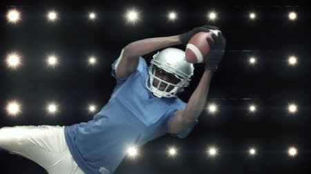 versenyképes : American football player against flashing lights in slow motion