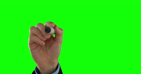 düşünürken : Businessman writing on an invisible board on green screen