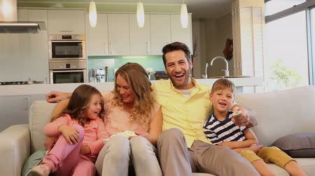 lounge : Family laughing on the sofa at home