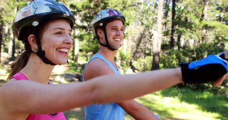bicycle : Couple biking through a forest in the countryside Stock Footage