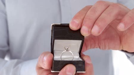 öneri : Close up of man making a proposal of marriage against white background