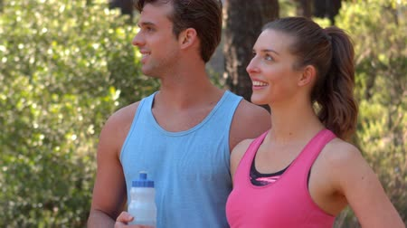 highspeed : Athletic couple taking a break while jogging