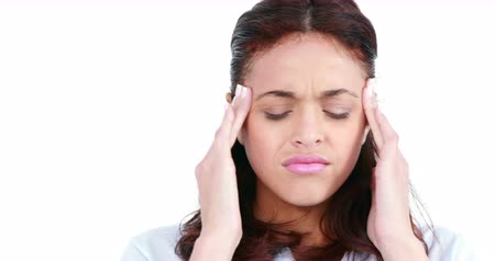 головная боль : Woman getting a headache against white background Стоковые видеозаписи