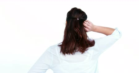 confuso : Rear view of woman scratching her head against white background