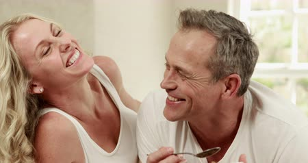 feed on : Handsome man feeding his wife at home Stock Footage