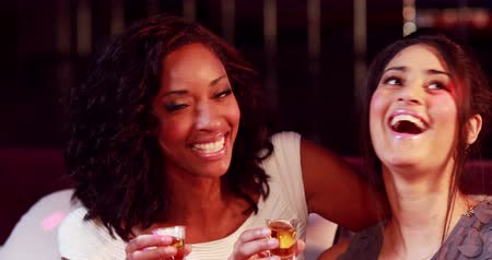 sparkling drink : Happy friends drinking shot in nightclub Stock Footage
