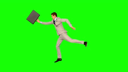running man : Businessman running and jumping in slow motion on green screen