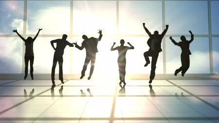 highspeed : Series of jumping business people in slow motion against room with large windows Stock Footage