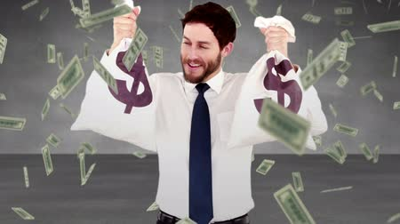 финансы : Composite video of smiling businessman holding money bags Стоковые видеозаписи