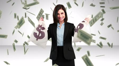 finanças : Composite video of happy businesswoman holding money bags